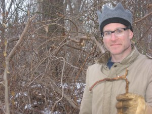 Sean Solomon with a root fragment of Celastrus orbiculatus