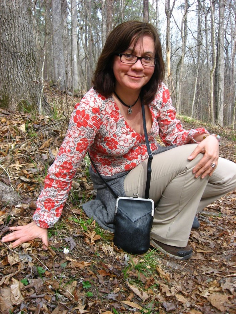 Isabelle Dijols overjoyed to see a bloodroot flower for the first time in 2011 - Sumter National Forest, South Carolina