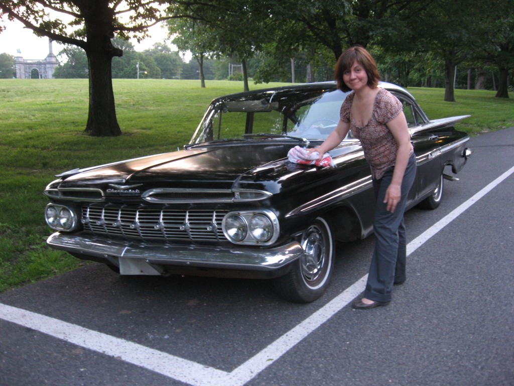 Isabelle buffs up our 1959 Chevrolet Impala in West Fairmount Park